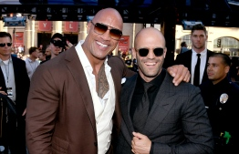 "(FILES) In this file photo taken on July 14, 2019 Dwayne Johnson (L) and Jason Statham arrive at the premiere of Universal Pictures' ""Fast & Furious Presents: Hobbs & Shaw"" at Dolby Theatre on July 13, 2019 in Hollywood, California. (Photo by KEVIN WINTER / GETTY IMAGES NORTH AMERICA / AFP)"