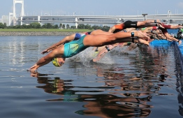 Athletes start the swimming competition of 2019 ITU World triathlon mixed relay series Tokyo, a test event ahead of Tokyo 2020 Olympic Games, at Odaiba in Tokyo on August 18, 2019. - JAPAN OUT (Photo by JIJI PRESS / JIJI PRESS / AFP) /