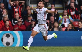 Sheffield United's English striker Billy Sharp celebrates after he scores the team's first goal during the English Premier League football match between Bournemouth and Sheffield United at the Vitality Stadium in Bournemouth, southern England on August 10, 2019. PHOTO: GLYN KIRK / AFP