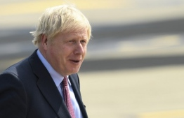 Britain's Prime Minister Boris Johnson lands at the Biarritz Pays Basque Airport in Biarritz, south-west France on August 24, 2019, on the first day of the annual G7 Summit attended by the leaders of the world's seven richest democracies, Britain, Canada, France, Germany, Italy, Japan and the United States. (Photo by Bertrand GUAY / AFP)