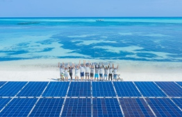 The Swimsol team pictured with solar panel platforms. PHOTO/LUX*