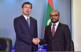 ADB President Takehiko Nakao (L) and Minister of Finance Ibrahim Ameer shake hands at the press conference held at the President's Office on August 26, 2019. PHOTO/PRESIDENT'S OFFICE