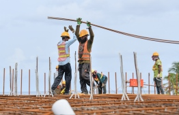 Expatriate workers during the construction of a bridge connecting phases 1 and 2 of Hulhumale'. FILE PHOTO: NISHAN ALI / MIHAARU