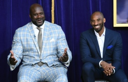 Shaquille O'Neal (L) and Kobe Bryant during the unveiling of a statue of O'Neal at the team's Staples Center arena. PHOTO: KEVORK DJANSEZIAN / GETTY IMAGES NORTH AMERICA / AFP