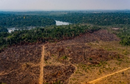 Handout picture released by the Communication Department of the State of Mato Grosso showing deforestation in the Amazon basin in the municipality of Colniza, Mato Grosso state, Brazil, on August 29, 2019. - A 60-day ban on burning in Brazil took effect Thursday after a global outcry over fires raging in the Amazon and data showing hundreds of new blazes in the rainforest but activists quickly doused hopes that the prohibition would work in the remote Amazon region where deforestation has surged this year as agencies tasked with monitoring illegal activities were weakened. (Photo by Mayke TOSCANO / Mato Grosso State Communication Department / AFP) /