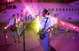 The cabin crew of Manta Air during the music video shoot of 'Windwalker' inside the Dhaalu Airport hangar. PHOTO/MANTA AIR