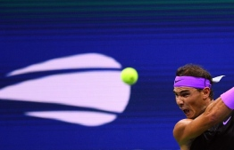 Rafael Nadal of Spain hits a return to Diego Schwartzman of Argentina during their Quarter-finals Men's Singles match at the 2019 US Open at the USTA Billie Jean King National Tennis Center in New York on September 4, 2019. (Photo by Johannes EISELE / AFP)
