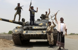 Fighters of the UAE-trained Security Belt Force, dominated by members of the Southern Transitional Council (STC) which seeks independence for south Yemen, are pictured on the outskirts of the Abyan province in southern Yemen on August 29, 2019. - The fighting between the government and the separatists, seen as a civil war within Yemen's already complex conflict, has sparked fears the country could break apart unless a peace deal is forged soon. (Photo by Saleh Al-OBEIDI / AFP)