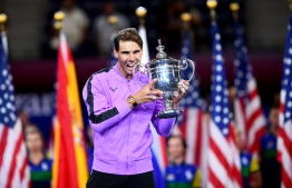 Rafael Nadal of Spain holds the trophy after his win over Daniil Medvedev of Russia during the men's Singles Finals match at the 2019 US Open at the USTA Billie Jean King National Tennis Center in New York on September 8, 2019. - Rafael Nadal captured his 19th career Grand Slam title in thrilling fashion on Sunday by winning the US Open final, outlasting Russia's Daniil Medvedev 7-5, 6-3, 5-7, 4-6, 6-4 to seize his fourth crown in New York. (Photo by Johannes EISELE / AFP)