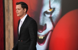 "(FILES) In this file photo taken on August 26, 2019 Swedish actor Bill Skarsgard arrives for the World premiere of ""It Chapter Two"" at the Regency Village theatre in Westwood, California. - Pennywise, the murderous clown who lurks in sewers and feasts on terrified children, is perhaps the most evil creation to ever emerge from the warped mind of Stephen King. But the director of the record-breaking, two-part film adaptation of ""It"" has controversially claimed that King's horrifying invention shares a lot in common with a real-life figure -- President Donald Trump. (Photo by Robyn Beck / AFP)"