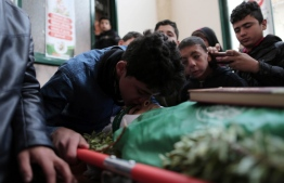 A file photo of Ali al-Ashqar, one of the Palestinian teens killed during the protests on September 6,  bidding a final farewell to a friend who died during a previous protest. PHOTO: MAHMOUD AJJOUR/ APA IMAGES