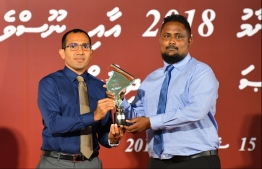 Mohamed Hamdhoon, of Mihaaru, accepts the awards for Sports and Feature (Print and Online Newspaper) at the Maldives Journalism Awards 2018, on September 15, 2019.