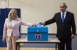 Israeli Prime Minister Benjamin Netanyahu and his wife Sara cast their votes at a voting station in Jerusalem on September 17, 2019. (Photo by Heidi Levine / POOL / AFP)