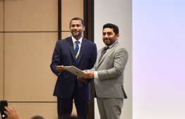 Managing Director of ADK Hospital Ahmed Affaal and Minister of Health Abdulla Ameen launches science journal and a medical application at Brain and Spine Conference 2019. PHOTO: HUSSAIN WAHEED/MIHAARU