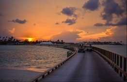 A sunset photographed from the first integrated leisure and entertainment resort 'Crossraods' in Maldives. The island nation, heavily reliant on income from the tourism industry, is estimated to suffer the worst economic contraction in South East Asia. PHOTO: HUSSAIN WAHEED / MIHAARU