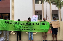 Volunteers gathered in front of the parliament as part of the global Climate Strike. PHOTO: SAVE MALDIVES