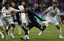 Paris Saint-Germain's Brazilian forward Neymar shoots to score a goal during the French L1 football match between Olympique Lyonnais (OL) and Paris Saint-Germain (PSG) at the Groupama stadium on September 22, 2019 in Decines-Charpieu, near Lyon. (Photo by JEFF PACHOUD / AFP)