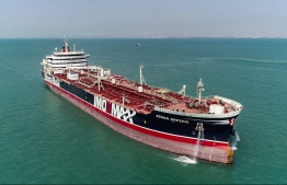 This picture taken on September 27, 2019 shows the British-flagged oil tanker Stena Impero as it leaves Bandar Abbas port in southern Iran. - The British-flagged oil tanker Stena Impero, which had been held off the Iranian port of Bandar Abbas for more than two months, set sail on September 27 and reached international waters, the provincial maritime organisation and its owner said. The ship's seizure was widely seen as a tit-for-tat move after authorities in the British overseas territory of Gibraltar detained an Iranian tanker on suspicion it was shipping oil to Syria in breach of EU sanctions. Tehran repeatedly denied the cases were related. (Photo by Mehdi DEHDAR / fars news / AFP)