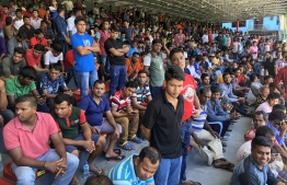Expatriates wait for a chance at registration at the National Football Stadium, Galolhu Dhandu,  capital city Male'. PHOTO: NISHAN ALI / MIHAARU