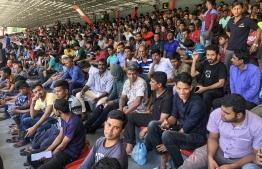 Expatriates seeking re-registration at the National Stadium in 2019. PHOTO: NISHAN ALI/ MIHAARU
