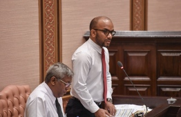 Minister of Finance Ibrahim Ameer speaking at a parliament session. PHOTO: PARLIAMENT