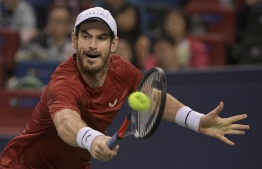 Andy Murray of Britain hits a return against Juan Ignacio Londero of Argentina during their first round men's singles match at the Shanghai Masters tennis tournament in Shanghai on October 7, 2019. (Photo by NOEL CELIS / AFP)