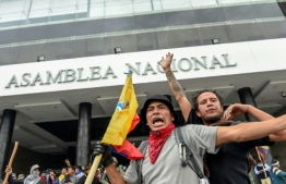 Demonstrators outside the national assembly in Quito during clashes with riot police. PHOTO: MARTIN BERNETTI / AFP