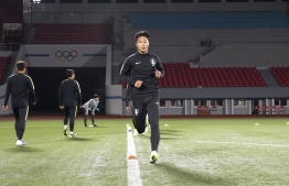 """This handout photo taken on October 14, 2019 by the Korea Football Association (KFA) shows South Korean national football team players warming up during a training session at the Kim Il Sung Stadium in Pyongyang, ahead of the World Cup 2022 qualifying Asian zone Group H football match between South Korea and North Korea. - The teams -- with Tottenham's star forward Son Heung-min included in the South Korean squad -- were expected to face each other at the Kim Il Sung Stadium on October 15. (Photo by handout / Korea Football Association / AFP) / - South Korea OUT / REPUBLIC OF KOREA OUT RESTRICTED TO EDITORIAL USE - MANDATORY CREDIT """"AFP PHOTO / KFA"""" - NO MARKETING NO ADVERTISING CAMPAIGNS - DISTRIBUTED AS A SERVICE TO CLIENTS  -  NO ARCHIVES"""