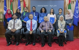 Top officials of Maldives National University (MNU) pictured with the individuals who received the research grants. PHOTO: MNU