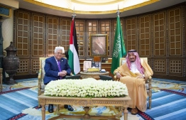 A handout picture provided by the Saudi Royal Palace on October 16, 2019, shows King Salman bin Abdulaziz (R) meeting with Palestinian president Mahmoud Abbas in the capital Riyadh. (Photo by Bandar AL-JALOUD / Saudi Royal Palace / AFP) /