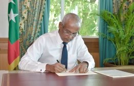 President Ibrahim Mohamed Solih ratifying a new bill. PHOTO/PRESIDENT'S OFFICE