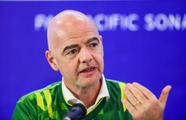 FIFA president Gianni Infantino gestures as he speaks during a press conference in Dhaka on October 17, 2019.  FIFA President Gianni Infantino arrived in Bangladesh for his one-day visit. Munir UZ ZAMAN / AFP
