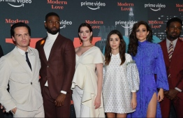"""(FILES) In this file photo taken on October 10, 2019, the cast of Amazon Prime Video's """"Modern Love"""" attends their premiere reception at the Museum of Modern Love (MoML) in New York City. - Every week, devotees of """"Modern Love"""" -- a Sunday column in The New York Times -- read all kinds of love stories: heartwarming, heartbreaking, inspiring, infuriating. Now, fans can get even more of the cult favorite: Amazon has adapted some of the most uplifting accounts into a feel-good series premiering on October 18, 2019, that runs counter to the dark, sarcastic tone of much of today's peak TV. (Photo by Angela Weiss / AFP)"""
