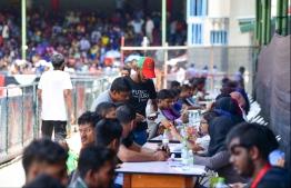 Undocumented workers seeking re-registration at the National Stadium. PHOTO: HUSSAIN WAHEED/ MIHAARU
