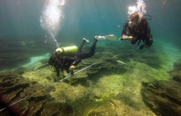 Researchers dive to inspect the condition of coral reefs in Maldives. PHOTO: BIOSPHERE EXPEDITIONS