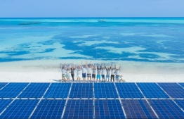 Swimsol team standing in front of the solar panels prior to installation. PHOTO: SWIMSOL MALDIVES