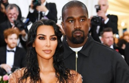 Kim Kardashian and Kanye West photographed here at the 2019 MET Gala, clad in a now-infamous Mugler creation. Kardashian-West, at the time, made news of the couple's dispute over the dress public. In the months and years that followed, US local media have written extensively about the Kardashian-West marital troubles, which are reportedly spurred by West's mental problems and Kardashian's public presence. PHOTO: DIMITRIOS KAMBOURIS / GETTY IMAGES