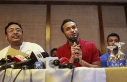 "Bangladesh national cricket team captain Shakib Al Hasan (C) speaks with journalist in Dhaka on October 23, 2019. - The boycotting Bangladeshi players made new demands on October 23, including a share of the board's revenue as a crisis surrounding cricket in the country deepened. Supreme Court lawyer Mustafizur Rahman Khan read out a list of 13 demands on behalf of the Bangladeshi cricketers at a news conference, which also included a ""feasible"" wage for female players. (Photo by STR / AFP)"
