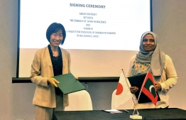 Ambassador of Japan to Maldives Keiko Yanai (L) and Fiyavathi's CEO Zeena Gasim at the ceremony where the Japanese government signed a grant of USD 48,500 to provide a minibus to 'Fiyavathi'. PHOTO/EMBASSY OF JAPAN