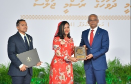 President Solih presents National Award of Recognition to Hishmath Faiz (C) and Ali Muaz, co-founders of Tiny Hearts of Maldives, for its contribution to social work. PHOTO: HUSSAIN WAHEED / MIHAARU