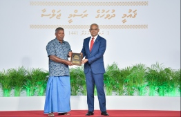 President Solih presents National Award of Recognition to Abdulla Shafeeq Nishan, for his contributions in the fisheries sector. PHOTO: HUSSAIN WAHEED / MIHAARU