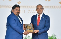 President Solih presents National Award of Recognition to Mohamed Shifan, for his contributions in the area of Dhivehi literature in promoting oratory skills. PHOTO: HUSSAIN WAHEED / MIHAARU