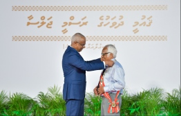 President Ibrahim Mohamed Solih confers the Order of the Distinguished Rule of Izzudeen on Ahmed Adam. PHOTO: HUSSAIN WAHEED / MIHAARU