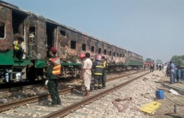 A train in Pakistan caught fire after a gas cylinder exploded. PHOTO: AFP