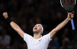 Bulgaria's Grigor Dimitrov celebrates after winning against Chile's Christian Garin during their men's singles quarter-final tennis match at the ATP World Tour Masters 1000 - Rolex Paris Masters - indoor tennis tournament at The AccorHotels Arena in Paris on November 1, 2019. - Dimitrov won the match 6-2, 7-5. (Photo by Christophe ARCHAMBAULT / AFP)