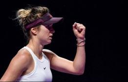 Elina Svitolina of Ukraine reacts during her women's singles match in the WTA Finals tennis tournament against Belinda Bencic of Switzerland  in Shenzhen on November 2, 2019. (Photo by Noel CELIS / AFP)