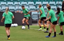 (FILES) In this file photo taken on February 27, 2019, striker Sam Kerr (2nd L) of Australia's national women's football team kicks the ball during a training session at Leichhardt Oval in Sydney. - Women footballers playing for Australia's national team will earn the same as their male counterparts under a deal unveiled on November 6, 2019 and hailed as landmark for gender equality in sport. (Photo by Saeed KHAN / AFP) /