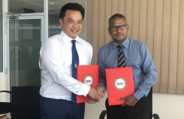 Representatives from Crossroads Maldives and the Ministry of Economics after signing the sponsorship agreement. PHOTO: MARCOMMS