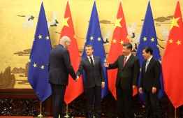 (L-R) European commissioner Phil Hogan, French President Emmanuel Macron, Chinese President Xi jinping and China's Commerce Minister Zhong Shan pose at the Great Hall of the People in Beijing on November 6, 2019. PHOTO: LUDOVIC MARIN / AFP