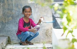 A little girl filling up a reusable bottle gifted by BML to Sh.Feydhoo. PHOTO: BML